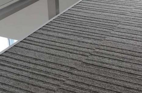 grey carpet tiles up close